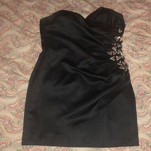 Black cocktail mini dress with embellished side